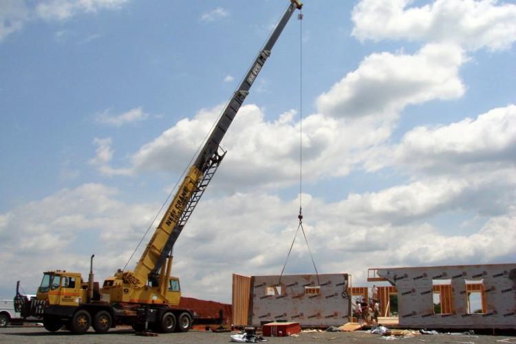 Crane Raising Walls